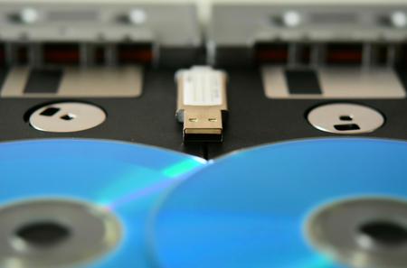 Tapes, floppy disk, cd, pen drive. Old and modern technology. Tilt-shift effect applied.