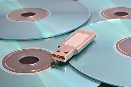 Many light blue cd and a pen drive.