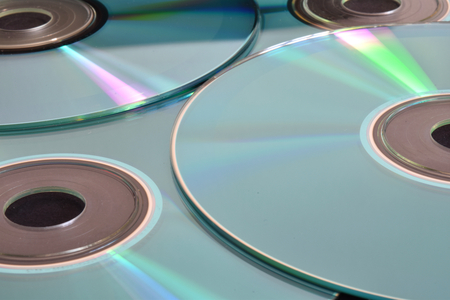 Many light blue cd. Suitable to be used like a background.