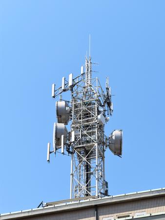 A big white antenna on blue sky Stock Photo