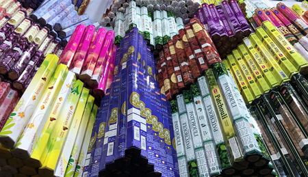 TURIN, ITALY, CIRCA MARCH 2018: many colorful incenses boxes on a street market. Editorial
