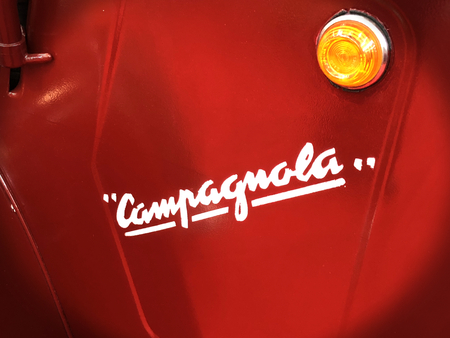 TURIN, ITALY, CIRCA FEBRUARY 2018: vintage old symbol of Fiat Campagnola car. Red metallic background.