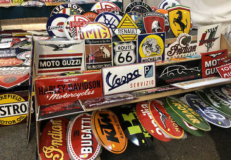 TURIN, ITALY, CIRCA FEBRUARY 2018: car and motorbike brand on metallic shiny and colorful cartels in a stand market. Hdr effect.