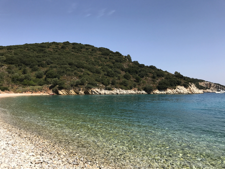 The beach of Filiatro with its white stones and turquoise sea in Ithaka or Ithaca in Greece