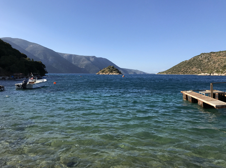 Turquoise sea between green mountains in Ithaka or Ithaca in Greece Stock Photo
