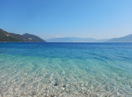 The transparent and turquoise sea of the beach of Saint John with blue sky in Ithaca island in Greece. Suitable to be used like a background. Editorial