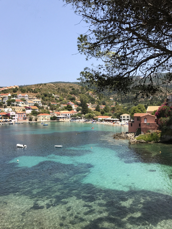 The Assos village with its turquoise bay and colorful buildings in Cephalonia or Kefalonia, Greece.