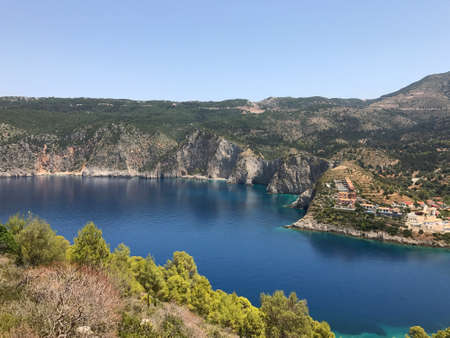 The high grey cliff on turquoise and blue sea near Assos in Cephalonia or Kefalonia, Greece