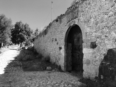 Ruins of the Venetian castle of Assos in Cephalonia or Kefalonia, Greece. Black and white. Stock Photo