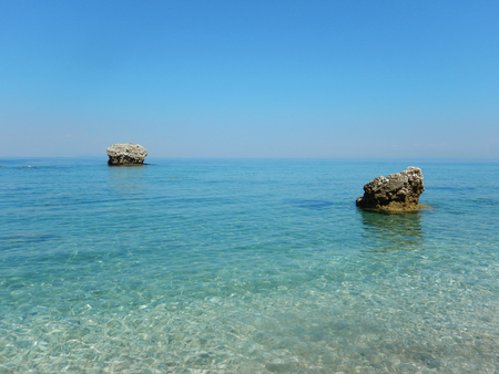 Transparent turquoise sea and rocks in Cephalonia or Kefalonia in Greece.