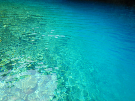 The turquoise water of the underground Melissani lake in Cephalonia or Kefalonia in Greece. Suitable to be used like a background.