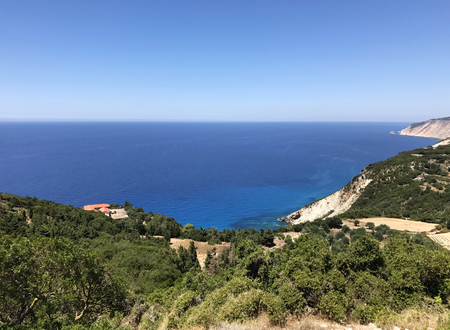 The green countryside and blue sea in the Lixouri peninsula in Cephalonia or Kefalonia, Greece