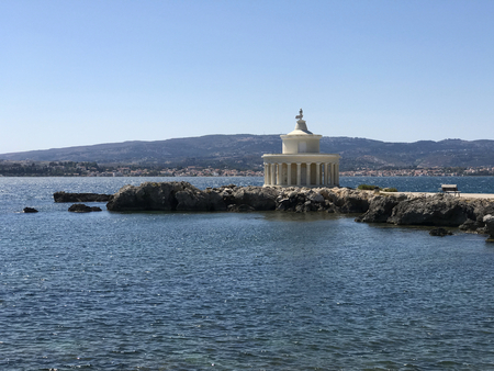 The lighthouse of Saint Theodoroi: a white marble temple on a cliff in Cephalonia or Kefalonia in Greece. Stock Photo