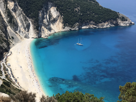 View of the bay of Myrtos beach between mountains with its white sand and turquoise sea, in the coast of Cephalonia or Kefalonia in Greece