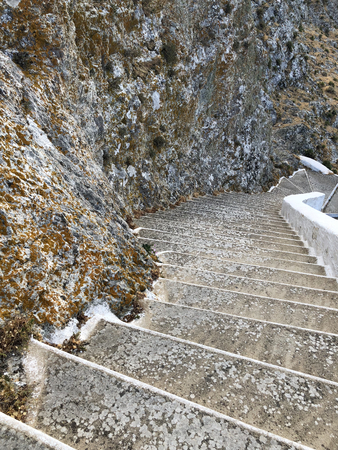 Grey spiral stone stairs in a mountains.