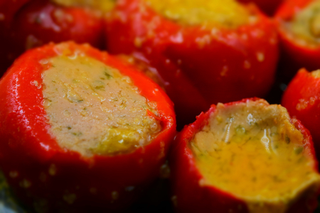 Close up of red peppers stuffed. Tilt-shift effect applied.