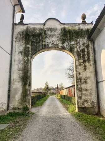 An ancient stone arc in the Monza Park in Italy. HDR effect.