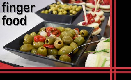finger food buffet with green olives