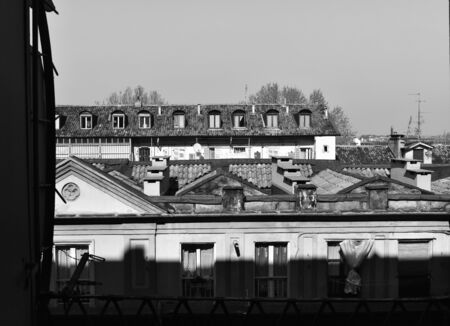 Turin city center in Italy in a sunny day; black and white.