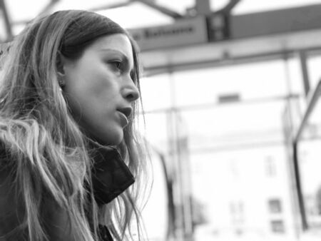 Profile of a beautiful caucasian young woman with long hair speaking. Copy space and black and white. Stock fotó