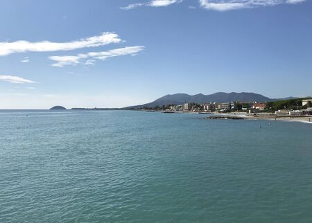The coastline with a town in Liguria, Italy, with turquoise sea and blue sky in a sunny day.