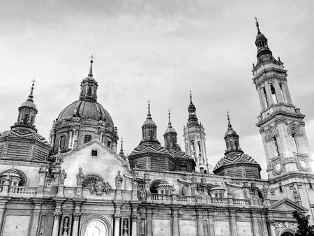 The Cathedral-Basilica of Our Lady of the Pillar, a Roman Catholic church in the city of Zaragoza, in Aragon, Spain. Black and white.