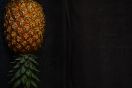 Isolated pineapple close up on a black background
