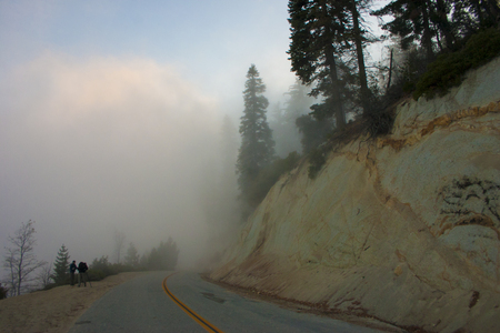 In the clouds on top of the mountain. The Sierra Nevada is a mountain range in the Western United States. Stock Photo