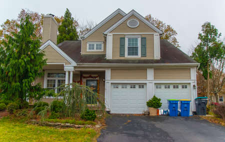 PRINCETON, NJ USA - NOVENBER 12, 2019: Typical modern wooden house in a suburb of Princeton in New Jersey, USA.
