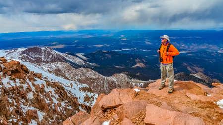 Colorado, USA - MAY 05, 2018: - Mountains in winter, tourist on the snowy slope of Pikes Peak mountains, Colorado, USA