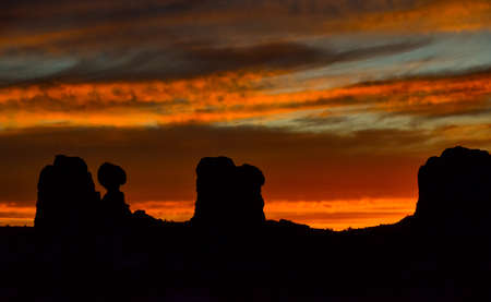 Evening sunset against the backdrop of the mountain landscape, and the red mountains. Canyonlands, Moab, Utah USA