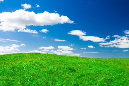 Green hill under blue cloudy sky Stock Photo - 3121047