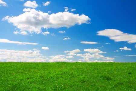 Green hill under blue cloudy sky Stock Photo - 3150402