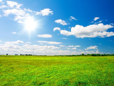 Green hill under blue cloudy sky whit sun Stock Photo - 3869217