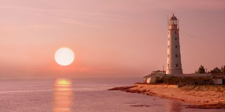 lighthouse and sunset Stock Photo