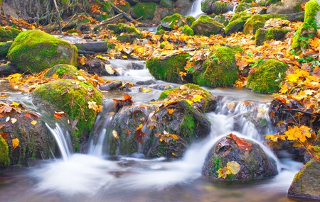 beautiful cascade waterfall in autumn forest Stock Photo