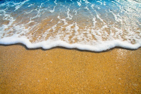 tide: sand and wave background Stock Photo
