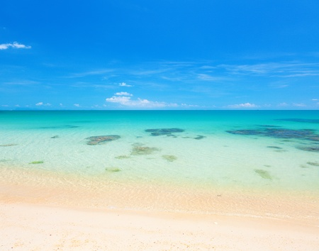beach and clear tropical sea photo