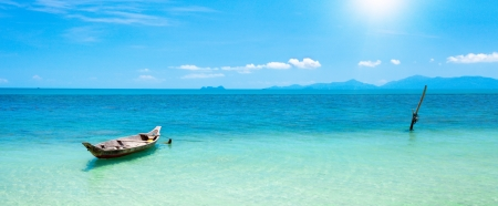 panoramic beach: boat and beautiful blue ocean