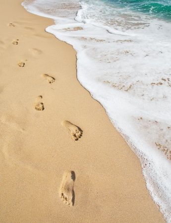 beach, wave and footsteps