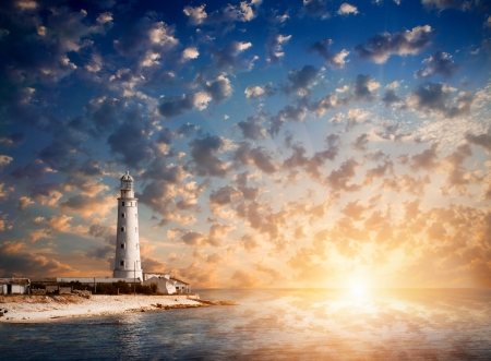 lighthouse and beautiful sunset Stock Photo