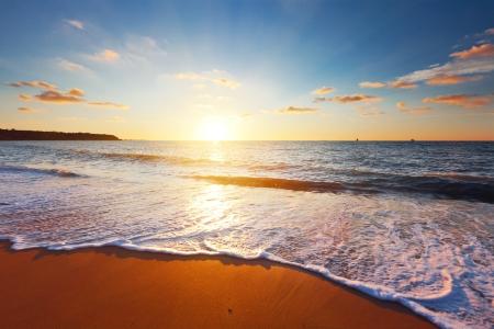 sunset beach: sunset and sea Stock Photo