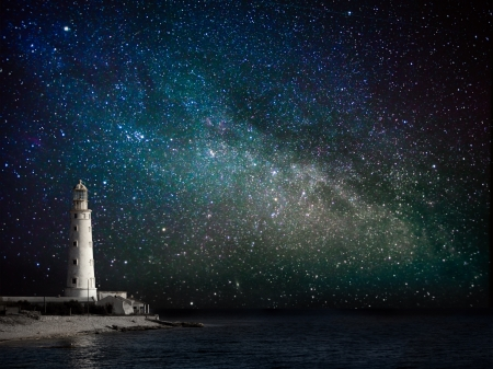 lighthouse with beam: lighthouse at night