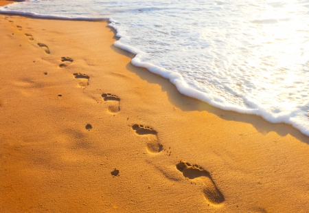 footsteps of one-legged people at sunset time