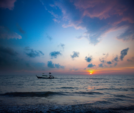 Longtail boats and sunset. Khao Lak, Thailand. photo