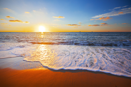 sunny beach: sunset and sea Stock Photo