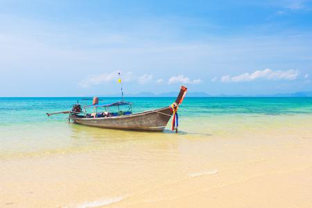 the clear sky: Long tail boat on tropical beach, Krabi, Thailand Foto de archivo