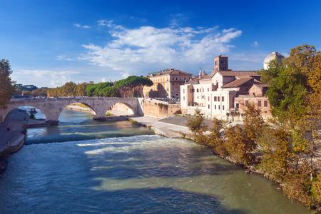 tevere: Tiber Island and Pons Cestius bridge in Rome, Italy Editorial