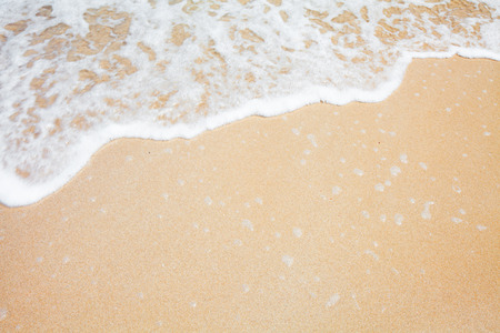 shore: sand and wave background Stock Photo