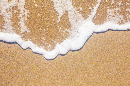 sand and wave background Stockfoto